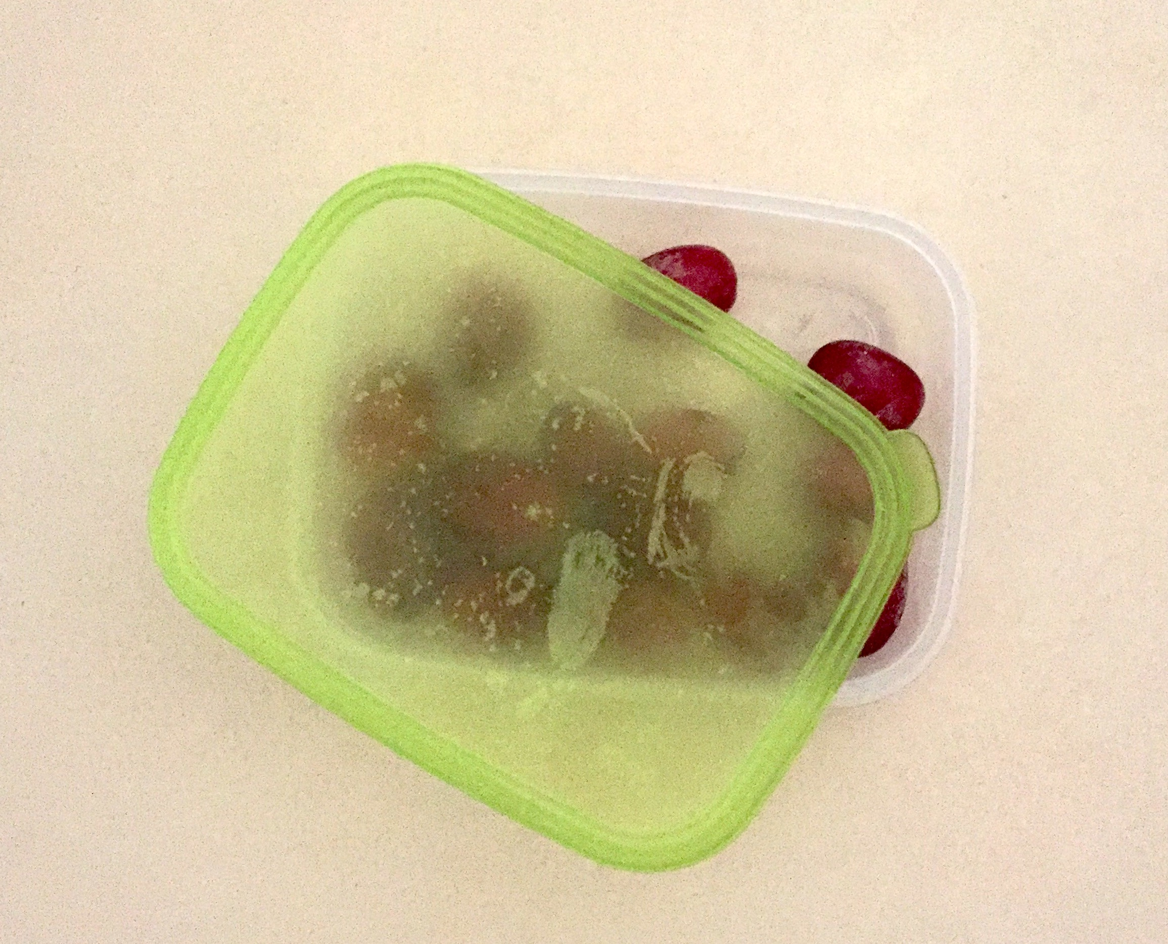 Frozen Grapes in Plastic Container